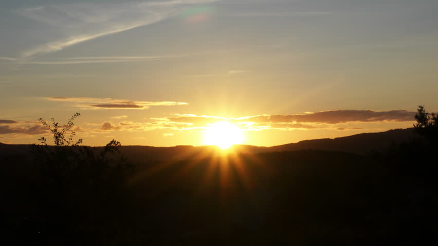 Timelapse from a sunset above the hills. Shooting stars can be seen.
