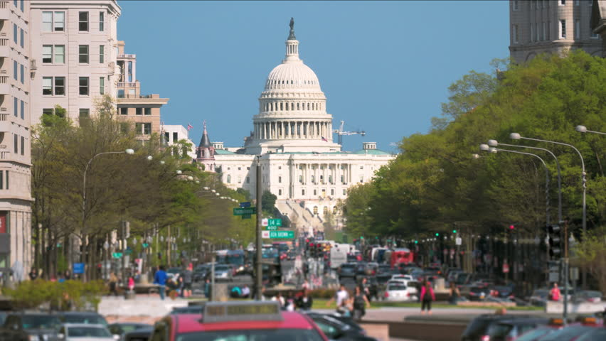 United States USA Capitol Hill Washington, D.C. with city traffic and Capitol Building background