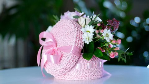 Flower bouquet in pink basket, in the rays of light, rotation, the floral composition consists of hydrangea, hrysanthemum bacardi, Rose lydia, Rose pion-shaped, eucalyptus