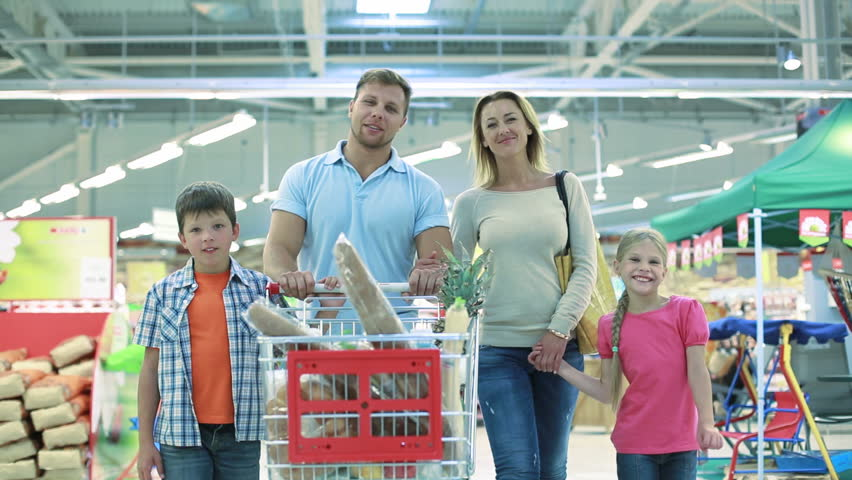 Smiling family of four enjoying shopping together