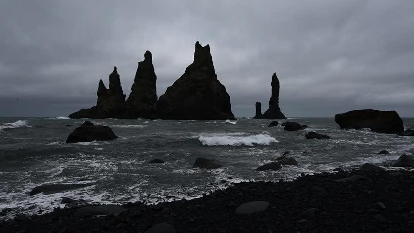 "Basalt rock formations ""Troll toes"" on black beach. Reynisdrangar, Vik, Iceland"