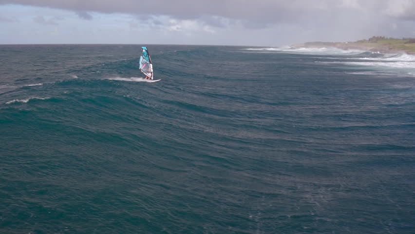A Girl Windsurfing On The Ocean
