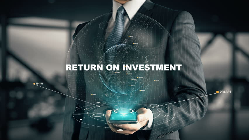 Businessman with Return On Investment hologram concept