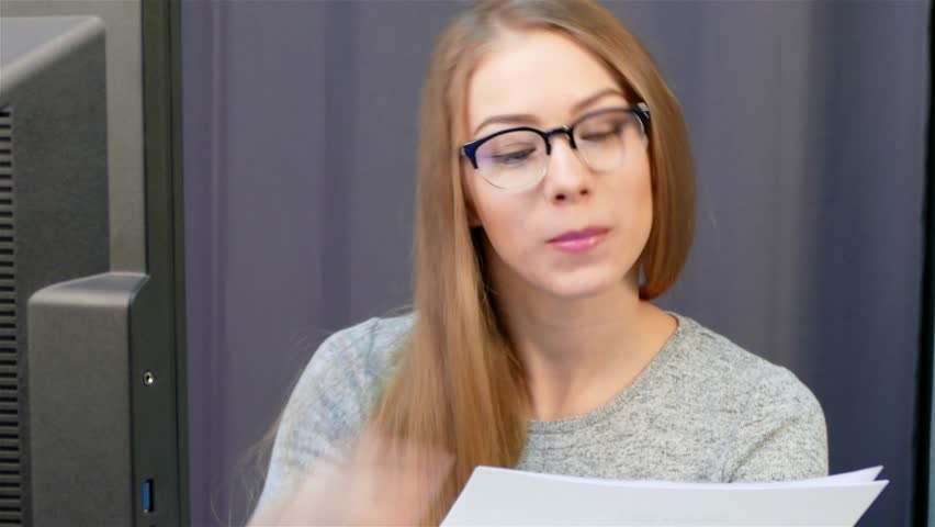 Woman - Office employee in the workplace is preparing important documents.   Shutterstock HD Video #27148474