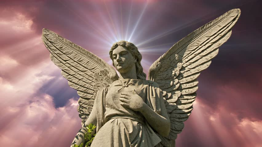 HD - The statue of an Angel on time lapse clouds (Loop).