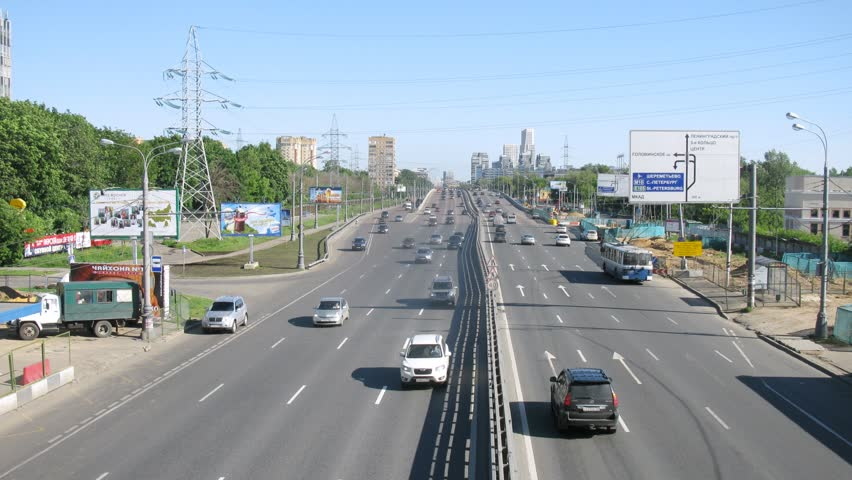 MOSCOW - JUN 17: (Timelapse View) Steam of cars quickly goes on Leningradskoye Highway, on Jun 17, 2012 in Moscow, Russia