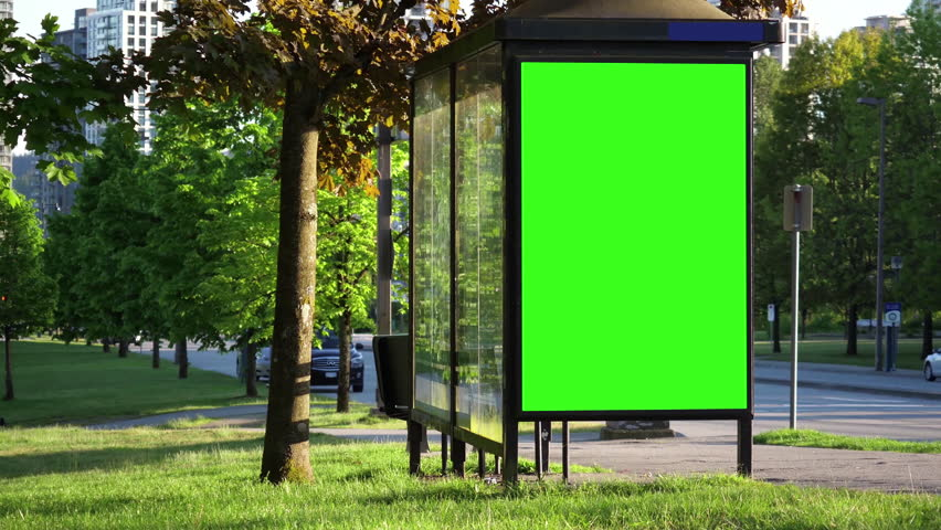 Green billboard for your ad at bus station with people crossing street 4k resolution