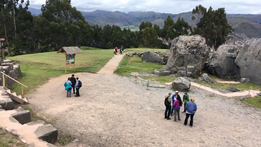 CUSCO, PERU -APR 12, 2017: Tourists at Monoliths in Qenko, an archaeological site in the Sacred Valley, Cusco, Peru. It is one of the largest holy places in the Cusco Region.