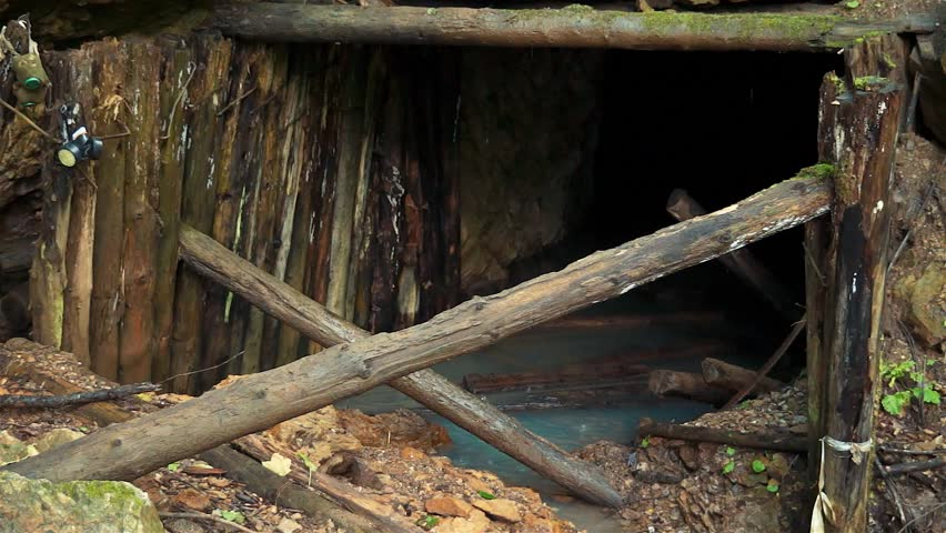 Uranium mine in Russia. Radioactive water at the entrance to the mine. Water, cloudy from radon dissolved in it.