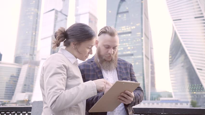 Business partners discuss the strategy of the business and build plans using paper and pen to write down my thoughts.   Shutterstock HD Video #27258610