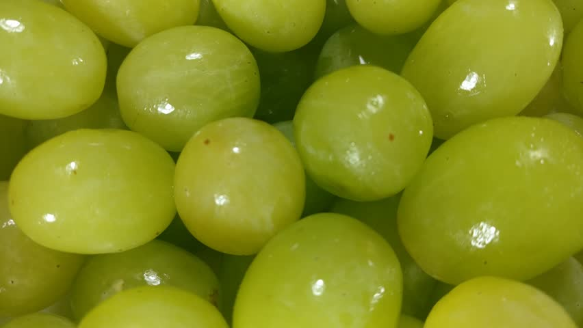 Great background of white (green) grapes  rotating close up. Footage will work great for any videos dealing with summer, fun, relaxation, wine making and much more.