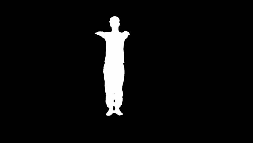 Silhouette of a young man breakdancing isolated on black.