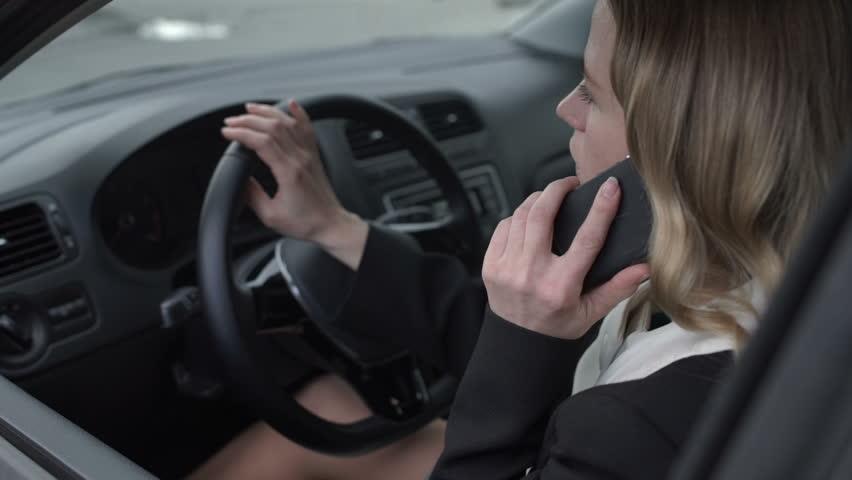 Girl talking on mobile phone in car