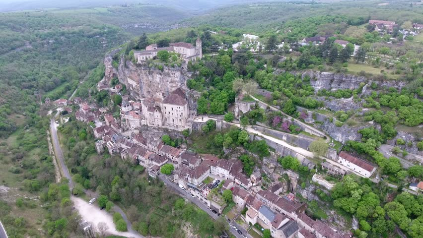 Aerial view. Flight crossing Rocamadour valley village on hillside, castle on top 3-3. Deep forest between montains, village and river  | Shutterstock HD Video #27386254