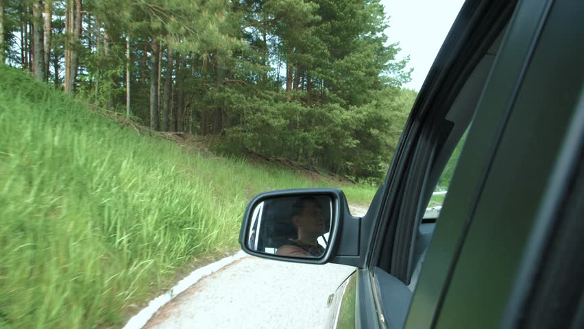 Young man driving a car, steadicam shot | Shutterstock HD Video #27388201