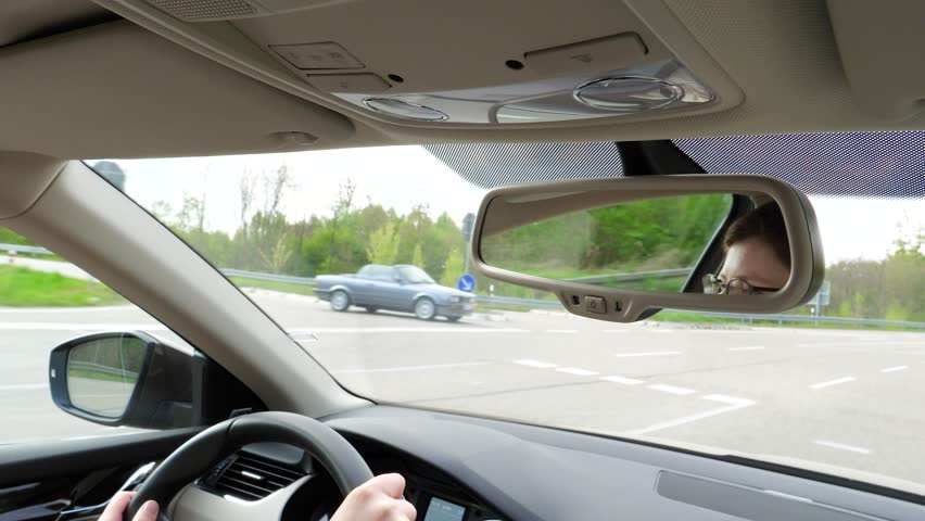 Car interior view of woman driving car on German autobahn in Baden-Wurttemberg Land | Shutterstock HD Video #27398884