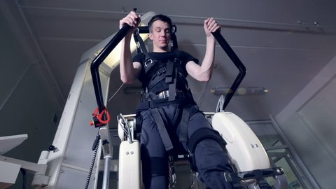 A person going through robotic rehabilitation therapy.