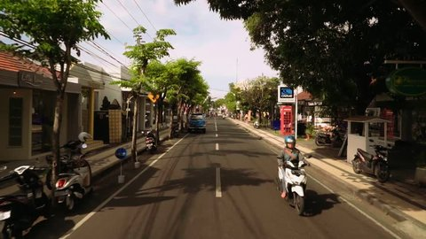 BALI, INDONESIA – JULY 16 2016: [Hyperlapse moving on Legian street, Bali, vehicle shot]