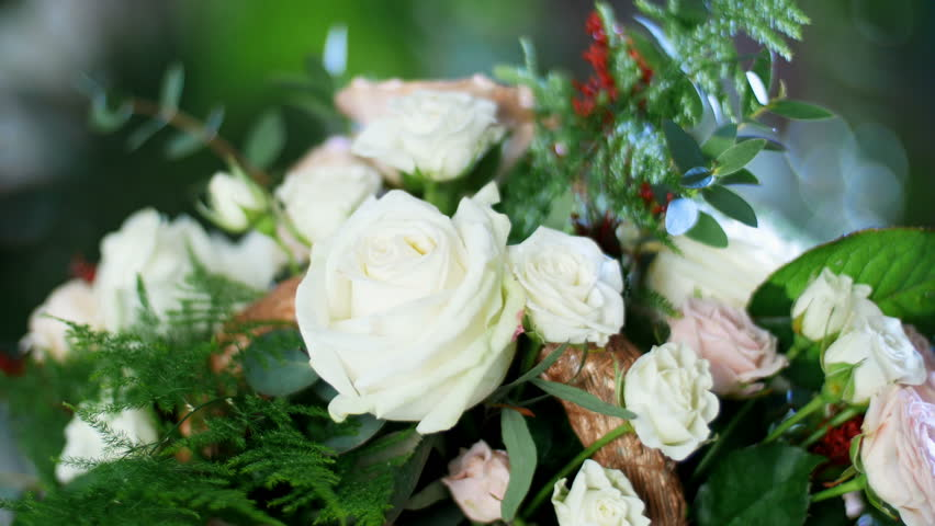 Close-up, Flower bouquet in the rays of light, rotation, consists of Rose cappuccino, Snowflake rose, Rose yana creamy, Plamosus, eucalyptus, solidago, Rose of avalanche. | Shutterstock HD Video #27438658