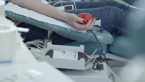 People at a blood transfusion station