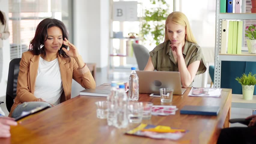 Secretary communicating with her female boss. Covers magazine visible on the video are out project and have proper PR. | Shutterstock HD Video #27468523