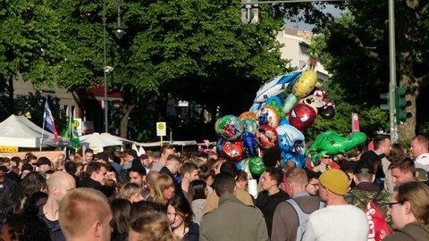 Berlin, Germany - june 04, 2017:   Crowded Street scene with many people and police on Karneval der Kulturen ( Carnival of  Cultures) in Berlin, Kreuzberg