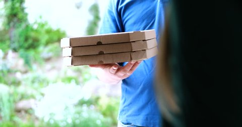 pizza delivery guy delivering pizza