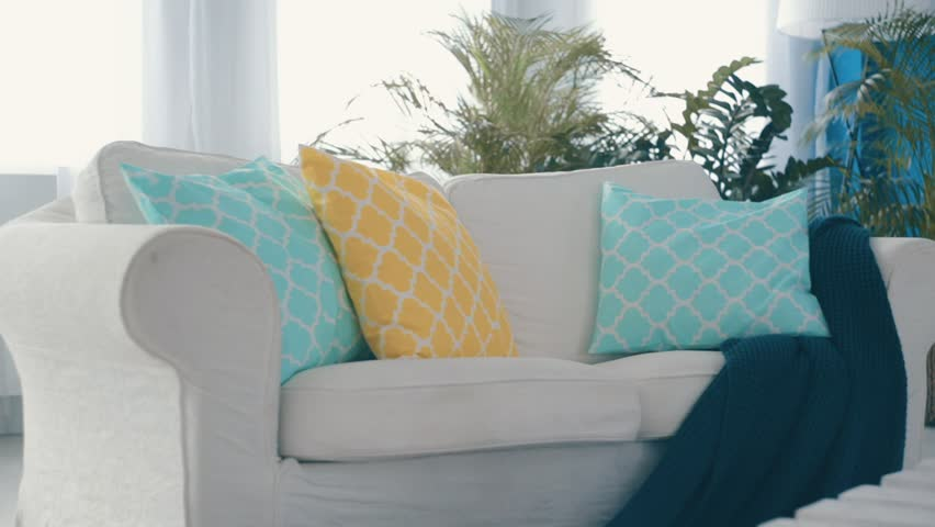 White settee with pillows in the bright apartment