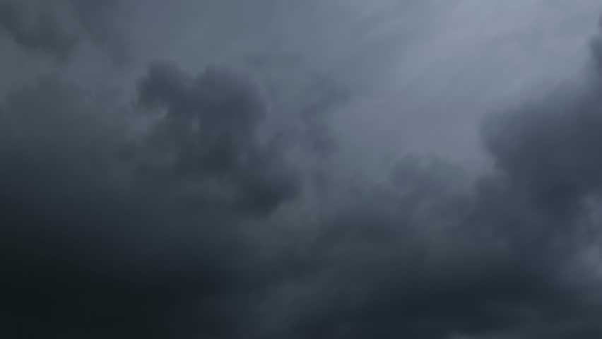 Time lapse of fast moving dark storm clouds. Shot with telephoto lens | Shutterstock HD Video #27483094