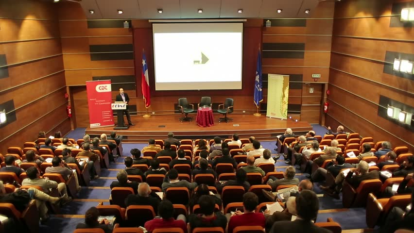 Caribbean jan 2014 cruise vacations more popular than ever as slow rack focus wide shot of auditorium during seminar sciox Images