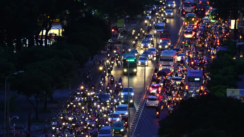 Ho Chi Minh City, Vietnam - April 2017 - Busy roads of Saigon, chaos on the street and above.
