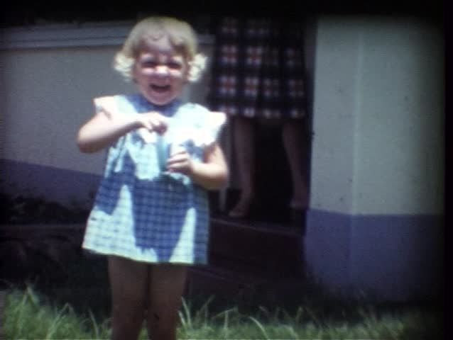 Vintage 8mm Film, A cute little girl trying to blow bubbles outside in the garden!  This was shot in the mid-1970s.