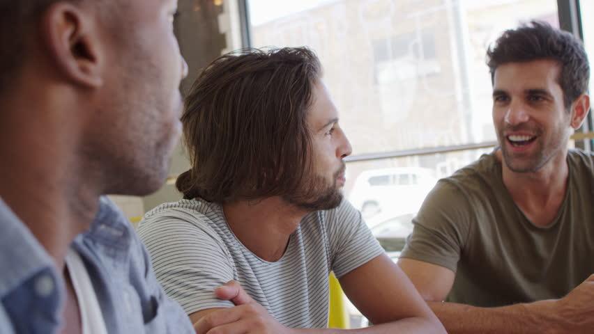 Three Male Friends Meeting In Coffee Shop Shot In Slow Motion | Shutterstock HD Video #27548416