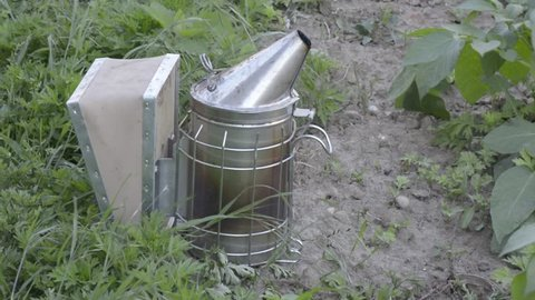 Beekeeping. Smoke blowers to calm bees and gain the honey.