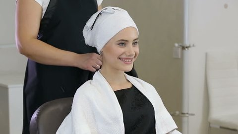Professional hairdresser, stylist preparing teen girl for hairdress