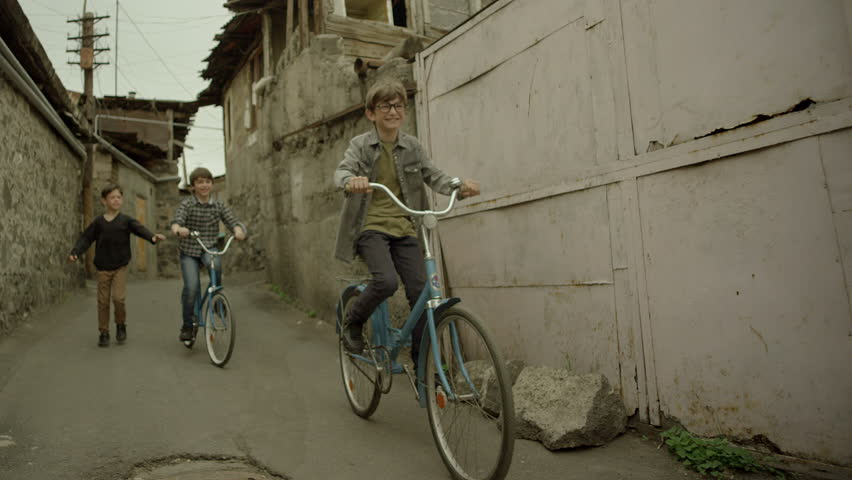 4K. Kids, Friends riding bikes, bicycles. Vintage times. Memories. Shot on RED EPIC DRAGON Cinema Camera in slow motion.