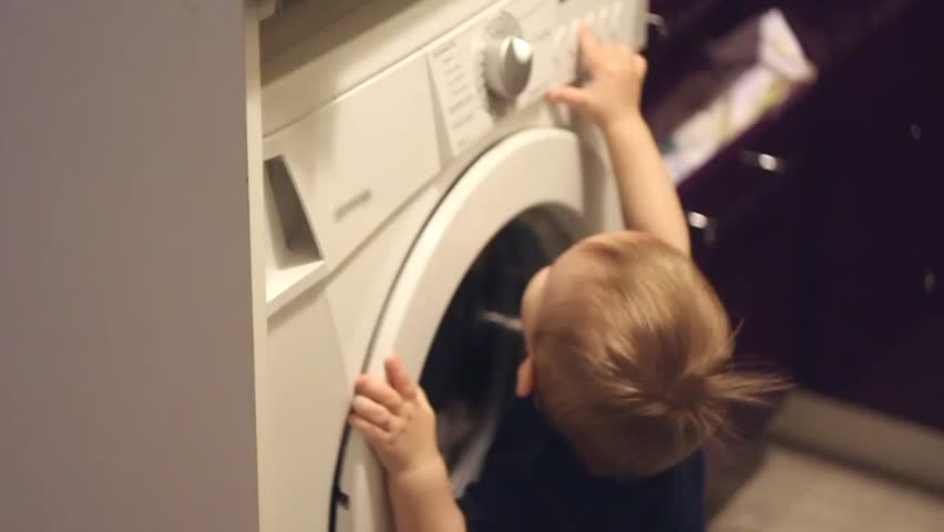 Heavy Bench Press Videos Part - 44: Little Caucasian Boy Touches The Washing Machine In Bathroom. - HD Stock  Video Clip