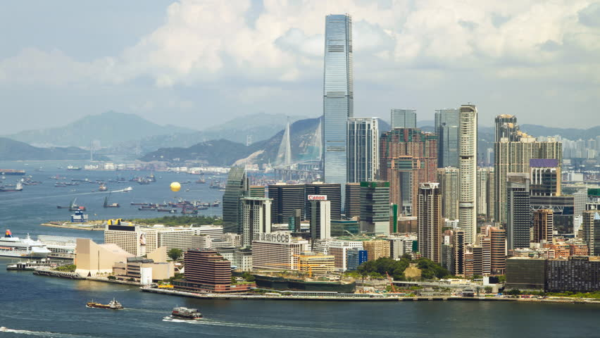 HONG KONG - AUGUST 6: Time lapse of Hong Kong Victoria Harbor and Kowloon Panorama Cityscape, View from Hong Kong Island on August 6, 2011 in Hong Kong, China.