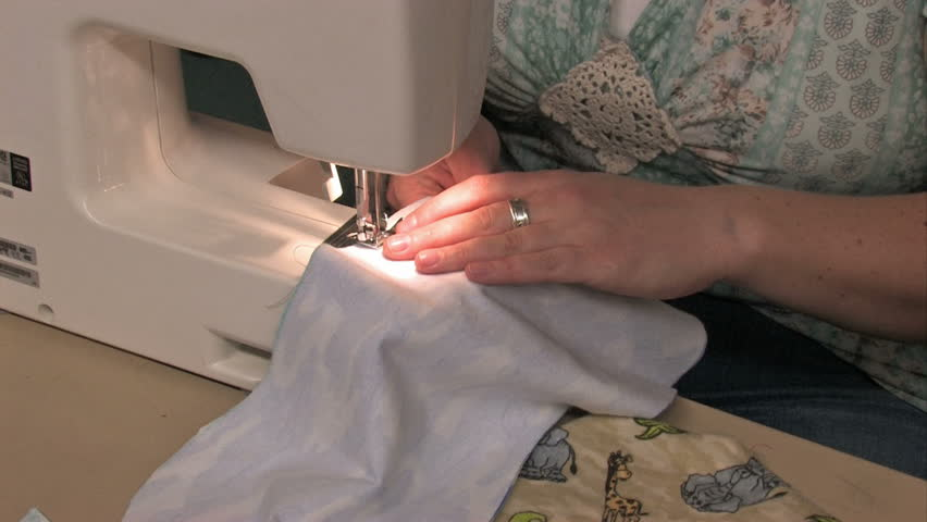 A Woman Sewing Fabric On Video De Stock Totalmente Libre De Extraordinary Sewing Machine For Making Clothes