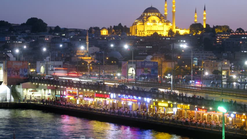 ISTANBUL - JUL 3: (Timelapse View) People have rest at restaurants under Galata Bridge, on Jul 3, 2012 in Istanbul, Turkey
