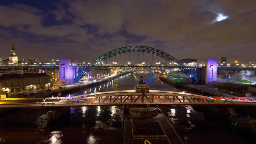 NEWCASTLE – CIRCA JANUARY 2012: Time lapse of the Millennium Bridge and the Sage Music Hall viewed from the Tyne Bridge, with early evening traffic going past in New Castle, England circa January 2012.
