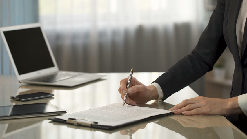 Female signing business contract, partners shaking hands, companies cooperation | Shutterstock HD Video #27707854