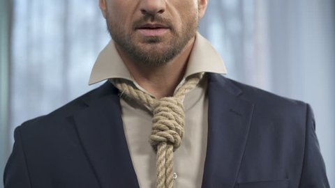 Handsome man fixing death rope on neck instead of tie, marriage of convenience