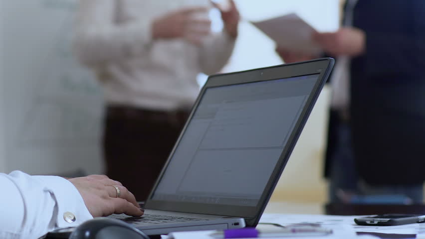 Female sales manager typing text on laptop, replying to e-mails from clients