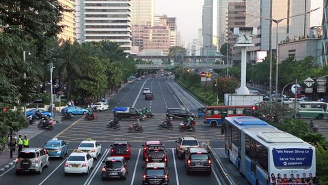 Heavy traffic along Thamrin avenue, the main road in the Jakarta business district in Indonesia capital city. The transjakarta bus system has its own traffic lane to beat the traffic congestion.