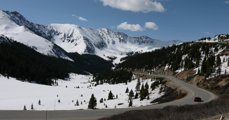 ROCKY MOUNTAINS, COLORADO - 2 JUN 2017: Arapahoe Basin Rocky Mountains spring snow car truck. Alpine ski area west of Denver. Loveland Pass road crosses peak at 11,990 feet on the Continental Divide.