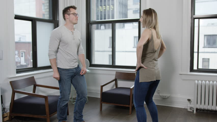 Young hip urban professionals dancing in white bright lofty living room of city apartment   Shutterstock HD Video #27725044