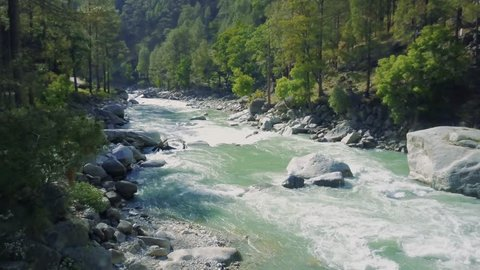 A holy river yamuna/ ganga flowing in the Himalayas
