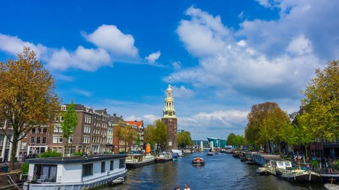 Amsterdam canal and clouds Hyper lapse / Time lapse. This tower is located close to central station and the famous red light district.