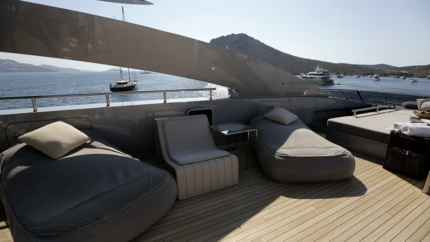 Interior of luxury motoryacht or motor boat on a warm sunny summer day. Wealth, money and lifestyle concept. Leisure activity.